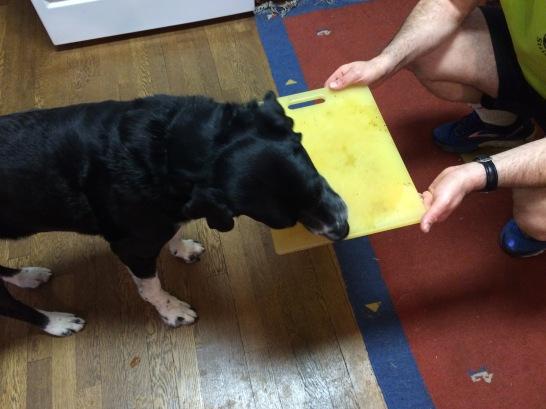 Pettigrew pre-cleans a cutting board.